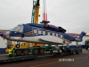 Crane lifting helicopter